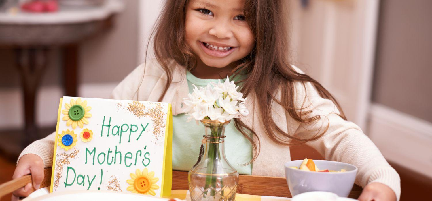 daughter bring food on try with happy mothers day card